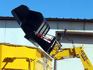 "HiDump Bucket in ""up"" position. Shown with spring hose holder."